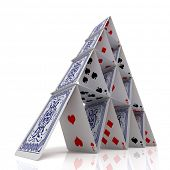 stock photo of collapse  - House of cards over a glossy white surface - JPG
