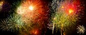 pic of firework display  - Colorful fireworks over dark sky during a celebration - JPG