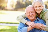 picture of heterosexual couple  - Outdoor Portrait Of Loving Senior Couple - JPG