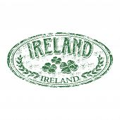 stock photo of ireland  - Green grunge rubber stamp with four leaf clovers and the name of Ireland written inside the stamp - JPG
