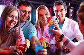 image of flirtatious  - Photo of pretty girls and smart guys looking at barman at party - JPG