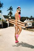 stock photo of board-walk  - Girl in sunglasses walking with longboard - JPG