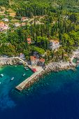 image of throne  - Helicopter aerial shot of beautiful small vilage and the oldest arboretum Trsteno near Dubrovnik - JPG