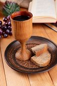 pic of communion-cup  - Cup of wine and bread on table close - JPG