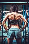 picture of arm muscle  - Athletic young woman showing muscles of the back - JPG