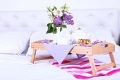 picture of bed breakfast  - Light breakfast and beautiful bouquet on bed - JPG