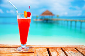foto of all-inclusive  - Red drink at a beach resort  - JPG
