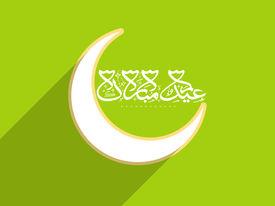 stock photo of ramazan mubarak  - Shiny crescent moon with arabic islamic calligraphy of text Eid Mubarak on green background - JPG