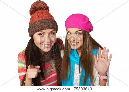 Two girl peeping into camera