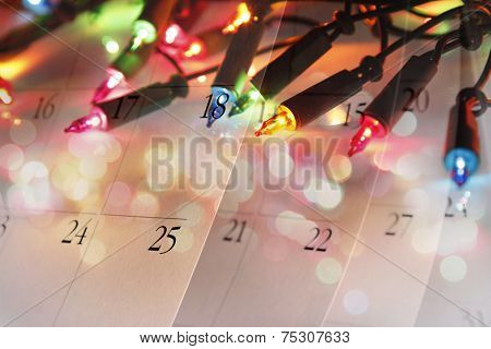 Christmas lights and calendar pages