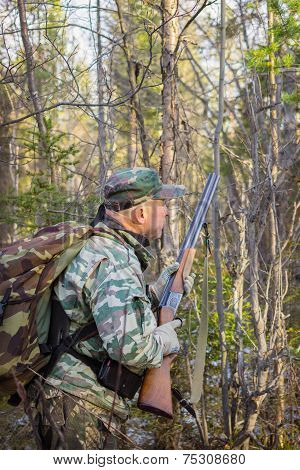 Hunter Stalks The Bird In The Forest