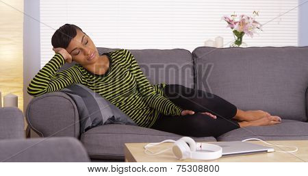 Attractive African Woman Sleeping On Couch