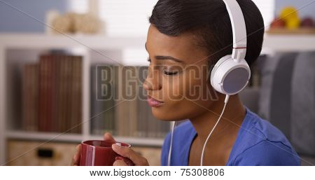 African Woman Jamming To Music With Mug