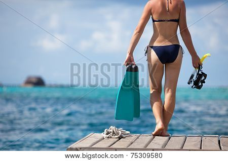 Woman With Snorkeling Equipment At Wooden Pier At Maldives