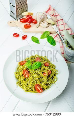 Spinach Tagliatelle With Basil Pesto And Mini Tomatoes