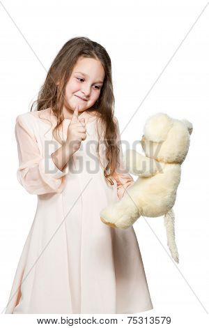 Girl Playing With A Toy Teddy Bear