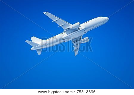 An image of an Airplane in the blue sky