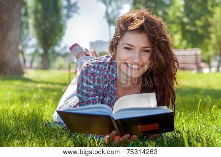 Girl With Book In The Summer Park