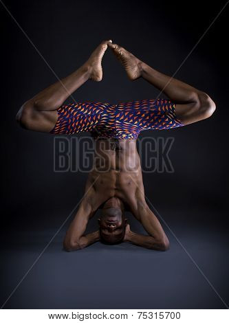 Upside Down Yoga on Grey Background