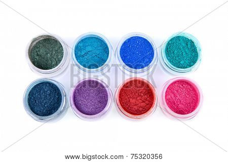 Set of colorful powder eye shadows, top view isolated on white background