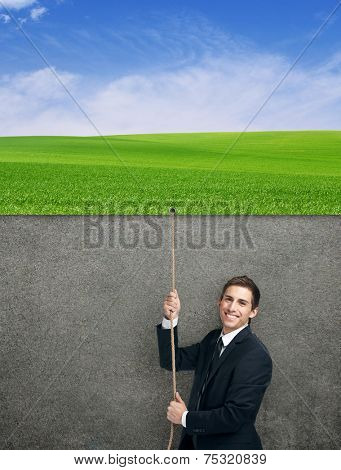 Half-length portrait of businessman swarming up the string with poster, isolated on white. Concept of job promotion and hard work