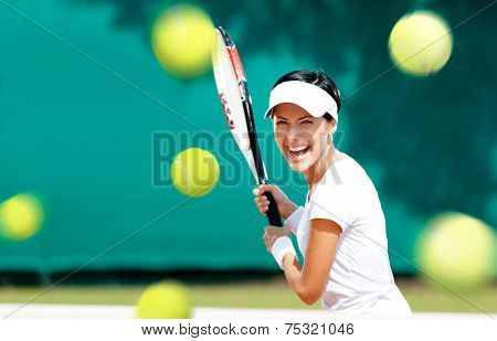 Young woman in sportswear plays tennis at contest