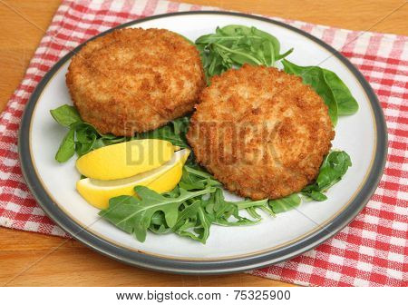 Cod fishcakes with rocket, watercress and spinach salad.