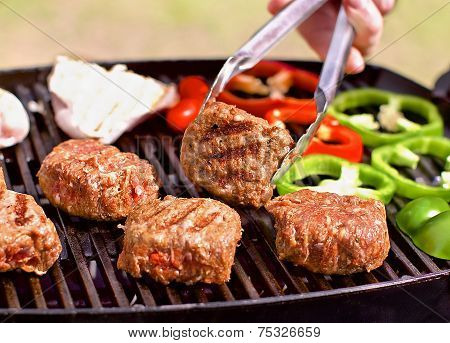 BBQ with burgers, pappers and mushrooms