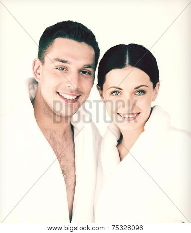 picture of couple in spa salon in white bathrobes