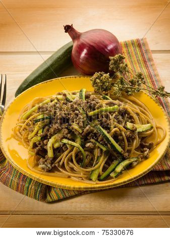 spaghetti with ragout and zucchinis