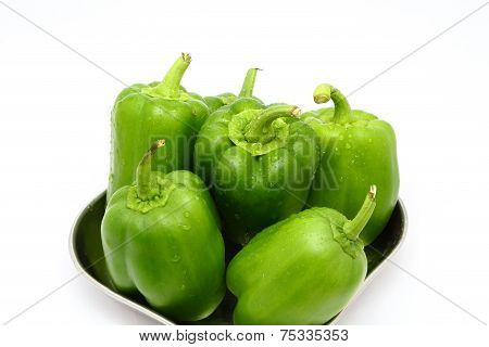 Green capsicum or pepper on white background, close up