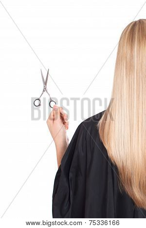 A Blond Holding Scissors And A Comb. Isolated On White Background.