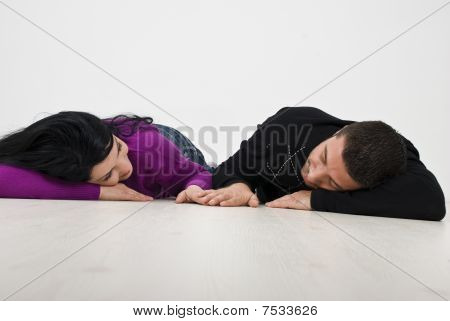 Young Couple Lying And Holding Hands