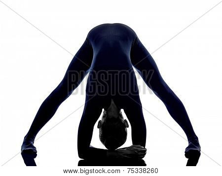 woman exercising Prasarita Padottanasana Wide Legged Forward Bend pose yoga silhouette shadow white background