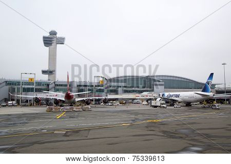 Air Traffic Control Tower and Terminal 4 with Virgin Atlantic  and EgyptAir planes at the gates in