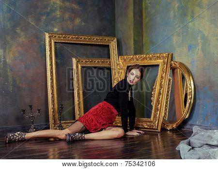 beauty rich brunette woman in luxury interior near empty frames