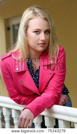 Pretty Blond Girl On Veranda
