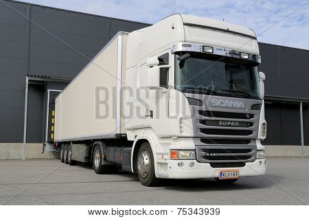White Scania R440 Semi Truck By A Warehouse