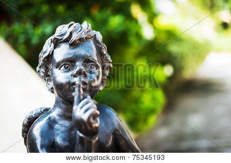 Boy Angel statue on stairway Shhh