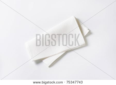 folded white napkin on white background