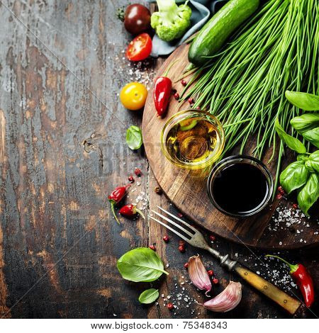 Healthy Bio Vegetables and spices on a Wooden Background