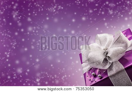 Christmas or Valentine's purple gift with silver ribbon abstract background.Christmas time.