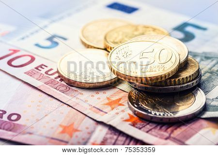 Euro money.Several euro coins and banknotes.
