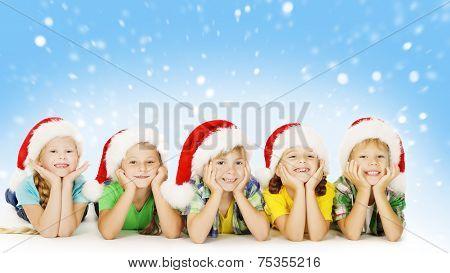 Christmas Children In Santa Helper Hat, Little Kids Boys And Girls Happy Greeting Xmas Holiday