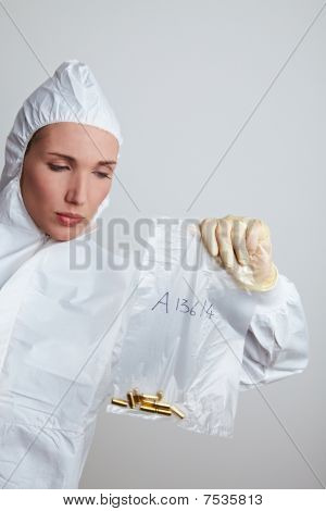 Forensic Scientist Securing Ammunition
