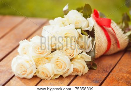 Beautiful bouquet of white roses on the floor