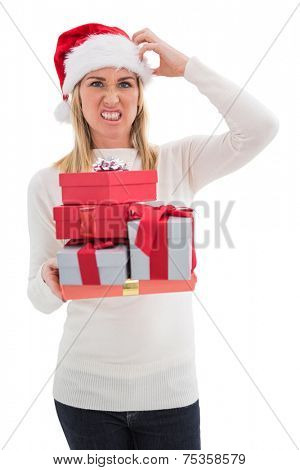 Stressed blonde in santa hat holding gifts on white background