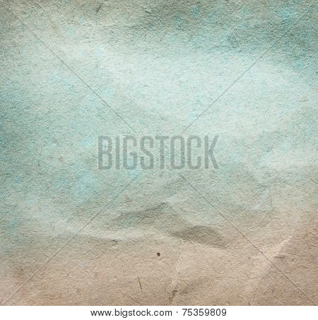 Retro paper background. faded early 1900's paper and light blue pigment.