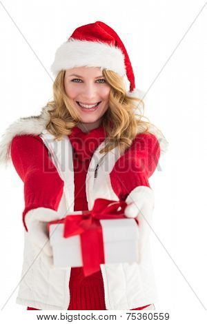 Festive blonde giving red gift on white background