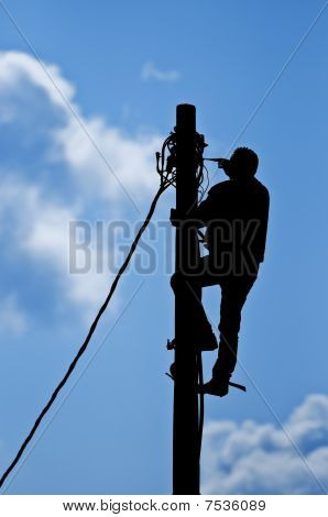 Man working on pole
